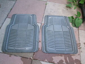 A SET OF TWO GRAY RUBBER FLOOR MATS