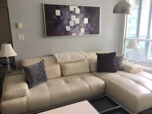 White Leather Rozzini Sectional from HOME DELIGHT