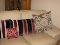 Designer cushions in new condition
