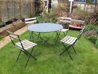 Vintage bistro set - table and four chairs.