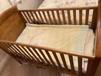 Baby cot converted into toddler bed with mattress