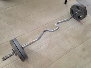 Curl bar with 4x10lb plates (Wonderful condition)
