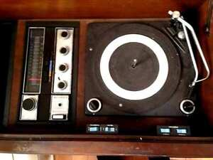 ANTIQUE RECORD PLAYER IN CABINET WITH ATTACHED SPEAKERS