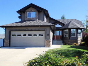 2 HEATED & INSULATED GARAGES - STORAGE FOR ALL YOUR TOYS!