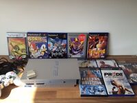 SILVER PS2 CONSOLE WITH 10 GAMES