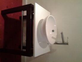 Free standing basin unit, ceramic top, tapand basin.