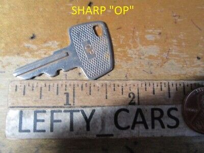 1 Sharp Cash Register Op Metal Cut Vintage Key - Used