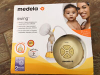 Breast pump medela + extra stuffs