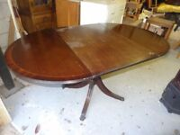 mahogany drop leaf table with claw feet and castors