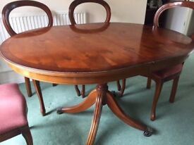 Regency reproduction dining room table with 6 chairs.