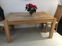 Lovely solid oak dining table