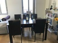 Dark wood dining table + 5 dark leather chairs