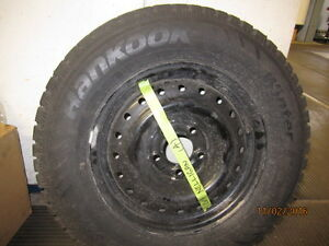 4 Hankook tires on steel rims c/w storage rack London Ontario image 1