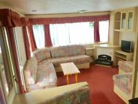 CHEAP static caravan for sale on Devon Bay holiday park. Close to beach, pets welcome,sea vies park.