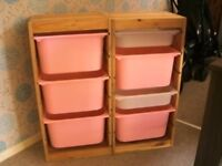 trofast cupboards with white and pink draws