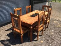 Solid wooden dining table with 6 chairs