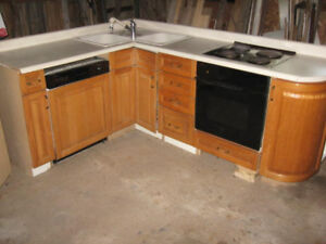 Oak kitchen cabinets, built in stove, dishwasher and sink