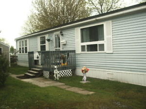 JUST REDUCED!! PREOWNED MINI HOME - MUST BE SEEN!!
