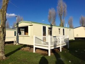 Family holiday home static caravan with decking and pitch fees