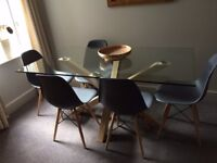 Evoque Glass top Dining table and 4 chairs