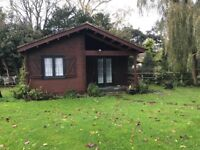SELF CONTAINED WOODEN CHALET - 2 BEDROOMS - UNFURNISHED - IN SALTWOOD - SHORT TERM LET 1 YEAR -