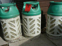 6 gas bottles previously used to power a gas barbeque.