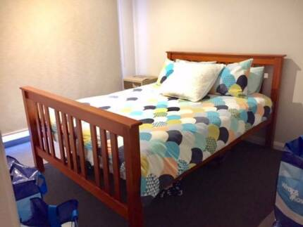 Queen size bed timber frame with mattress in good condition
