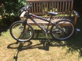 """Mountain Bike - Youth. 21 Gears. Saddle height approx 21"""" to 30""""."""