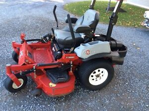 2 Exmark commercial style Lawn Mowers