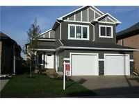 Beautiful Bi-Level 5 Bedroom Home with in-law suite!