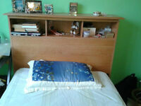 Adult bed with headboard and mattress
