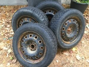 Four Goodyear Nordic snow tires on rims