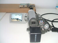 Panasonic Camcorder. Its an NV GS 27. Automatic focus.30 times zoom lens