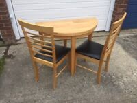 Drop Leaf Circular Table and Two Chairs