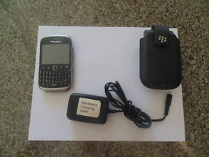 Blackberry Curve 9320 with charger and case.