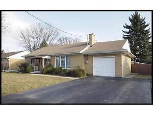 Well Up-Kept Bungalow Located on WIDE Lot!