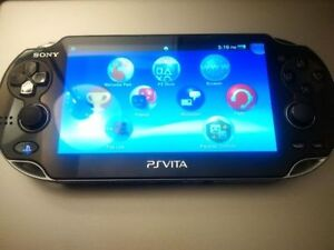 Ps Vita (OLed Model) with memory stick.