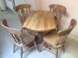 CIRCULAR BEECHWOOD TABLE AND 4 CHAIRS