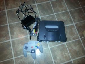 Nintendo 64 avec 2 manettes, rumble pak et jeux
