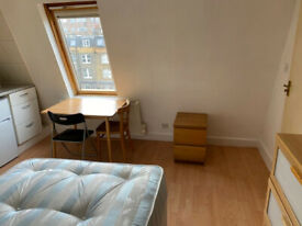091T-WEST KENSINGTON-DOUBLE STUDIO FLAT, FURNISHED, BILLS INCLUDED EXCEPT ELECTRICITY -£180 WEEK