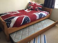 Solid single bed frame plus 2 mattresses, excellent condition.