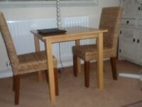 TABLE AND 2 X RATTAN HIGH BACK CHAIRS