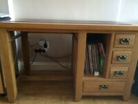 Substantial leather and oak office desk.