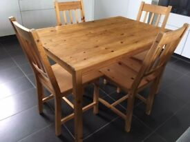 Ikea pine table and four chairs- good condition