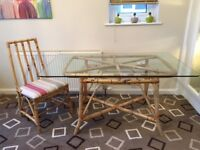 Glass topped dining table with 4 matching chairs.