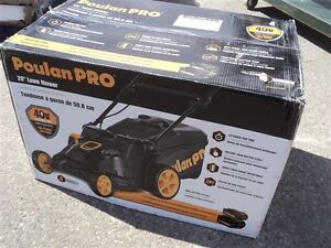 New in the box electric lawn mower