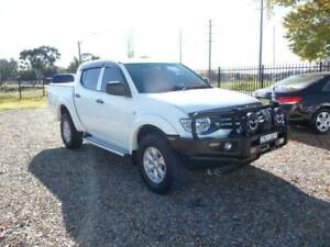 2013 Mitsubishi Triton NM GLX 4X4 Dual Cab Ute 2.5 Turbo Diesel Manual Orange Orange Area Preview