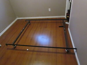 double mattress and bed frame.