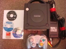 BLACK NINTENDO GAMECUBE WITH THREE GAMES , FOR SALE OR SWAP