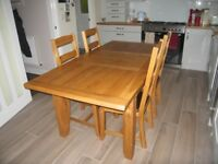 Oak dining table and six upholstery chairs